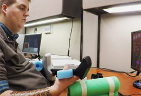 Paralyzed man regains hand movement using own brain signals